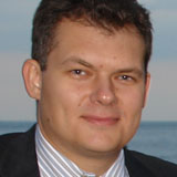 Dmitry Rakhlin, Ph.D.<br><span class=s_title>Global Head of<br>Quantitative Trading<br><em>AllianceBernstein, L.P.</em></span>