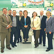 Members of Wal-Mart's Information Systems Division, at one of the retailer's Neighborhood Market stores. From left: Tony Puckett, Dan Phillips, Randy Salley, Rob Hey, Linda Dillman, Carol Mosely, Matt Carey, and Carolyn Walton.