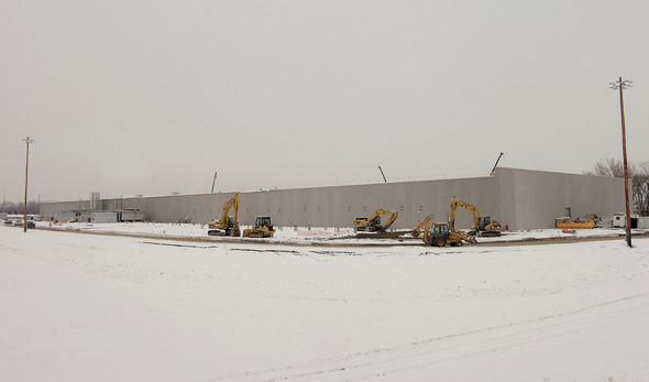 Construction temporarily halted by a December snowstorm.