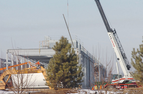 In February, cooling system sits atop north side of building.