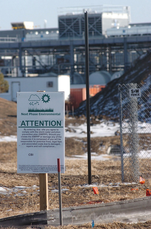 Sign calls attention to Storm Water Pollution Prevention Plan.