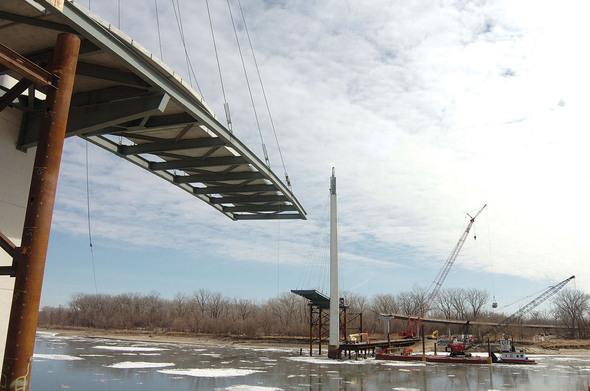 Pedestrian bridge under construction will span the Missouri River.