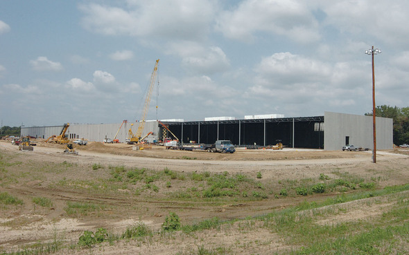 Data center's south wall nears completion.