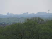 Downtown San Antonio rises through the hot Texas haze from the roof of the data center.