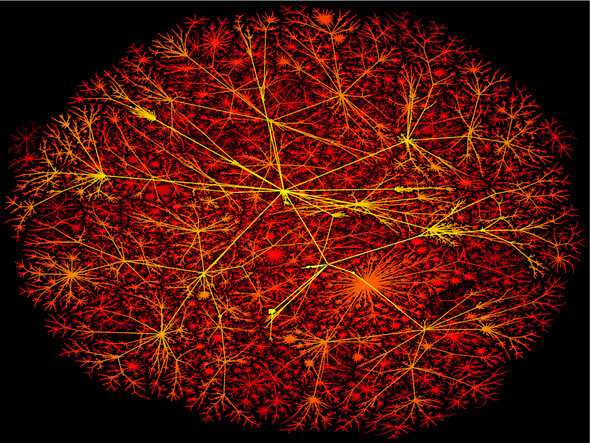 Global Brain? This image, captured in May 1999, maps all backbone routers based on distance from Lumeta's mapping host in New Jersey. On the color scale, yellow represents the closest nodes, while dark red is farthest away. Readers can construct their own metaphors about this image's similarity to neural networks of a human brain.